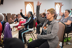 "6 December 2018, Charlotte, North Carolina, United States: Biweekly ""chairobics"" session, aerobics for people with limited mobility, in the Rockwell African Methodist Episcopal Zion Church, Charlotte, North Carolina."