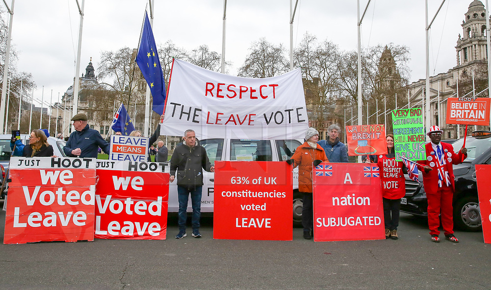 """© Licensed to London News Pictures. 20/03/2019. London, UK. Pro-Brexit demonstrators with large placards protest outside the Houses of Parliament. According to No 10 Downing Street, later today British Prime Minister Theresa May will write to European Union chiefs requesting a """"short"""" delay to the date Britain leaves the EU. Photo credit: Dinendra Haria/LNP"""