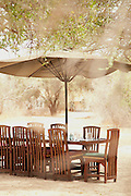 A lunch table setting at a luxury tented safari camp in the Selenkey Reserve, near Amboseli National Park, Kenya