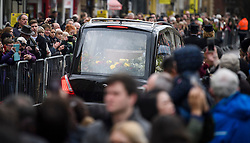 © Licensed to London News Pictures. 31/03/2018. Cambridge, UK. The coffin makes it's way through crowds of people after t funeral of Stephen Hawking at Church of St Mary the Great in Cambridge, Cambridgeshire. Professor Hawking, who was famous for ground-breaking work on singularities and black hole mechanics, suffered from motor neurone disease from the age of 21. He died at his Cambridge home in the morning of 14 March 2018, at the age of 76. Photo credit: Ben Cawthra/LNP