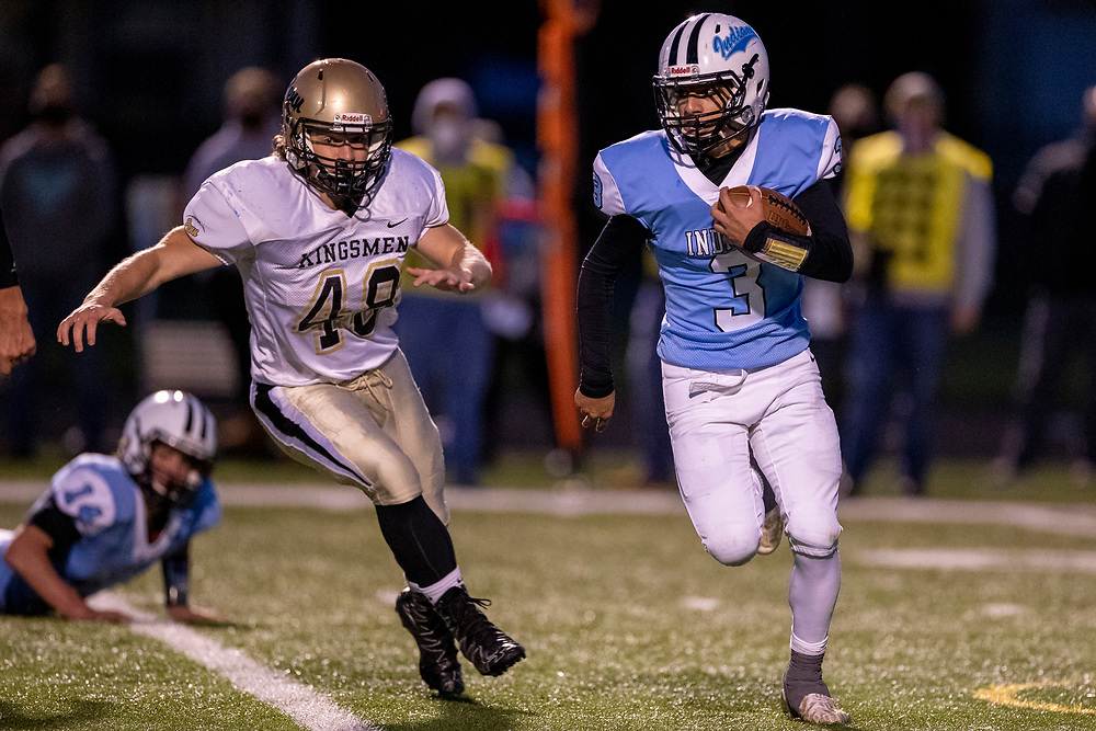 Saint Joseph's Alex Ortiz runs with the ball as Penn's Denton Cline pursues during the Penn Kingsmen-St. Joseph high school football game on Friday, October 02, 2020, at Father Bly Field at Leighton Stadium in South Bend, Indiana.