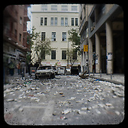 George street near the Athens Polytechnic the day after the big riot of the 7 of December 2008. <br /> <br /> Following the murder of a 15 year old boy, Alexandros Grigoropoulos, by a policeman on 6 December 2008 widespread riots, protests and unrest followed lasting for several weeks and spreading beyond the capital and even overseas<br /> <br /> When I walked in the streets of my town the day after the riots I instantly forgot the image I had about Athens, that of a bustling, peaceful, energetic metropolis and in my mind came the old photographs from WWII, the civil war and the students uprising against the dictatorship. <br /> <br /> Thus I decided not to turn my digital camera straight to the destroyed buildings but to photograph through an old camera that worked as a filter, a barrier between me and the city.