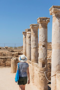 Tourist by columns in Paphos Archaeological Park in Cyprus