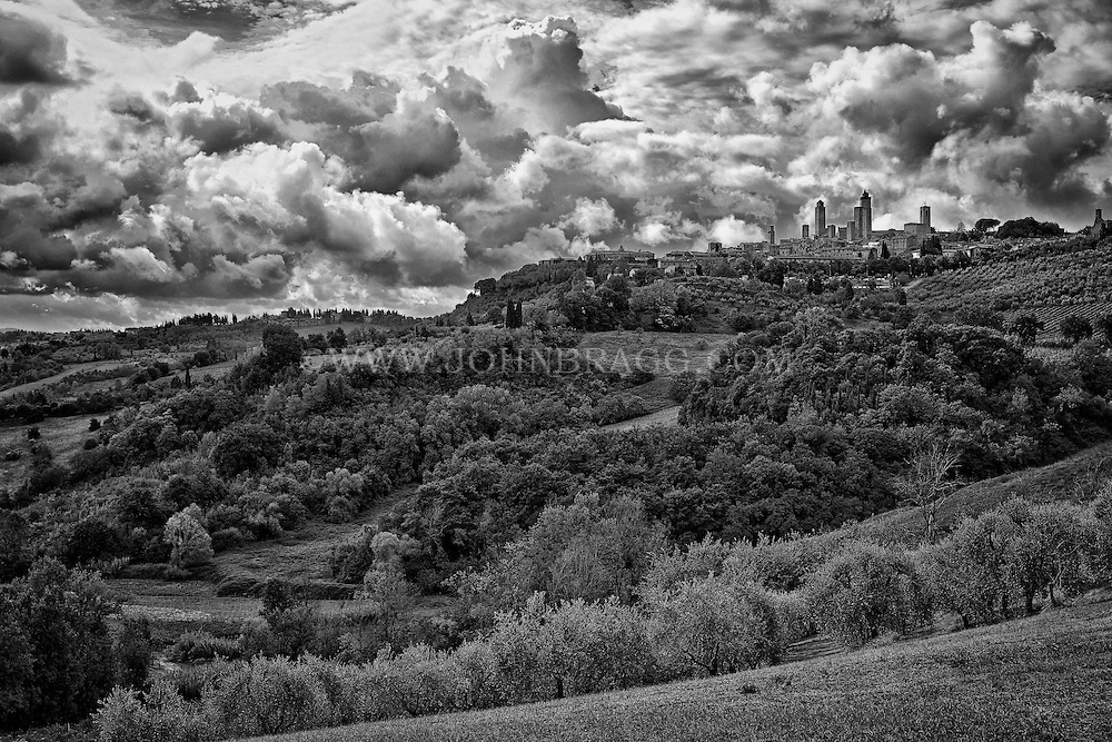 Black and white distant view of the walled, medieval city of San Gimignano in Tuscany, Italy.
