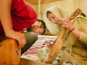 Students teach each others how to play Rubab at the Bulbulik music school in Gulmit village, upper Hunza.