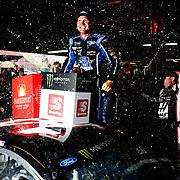 Clint Bowyer celebrates after winning a rain-shortened Monster Energy NASCAR Cup Series FireKeepers Casino 400 race at Michigan International Speedway in Brooklyn, Mich., on Sunday, June 10, 2018. THE BLADE/KURT STEISS