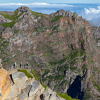 Tourists standing at a lookout point at Pico do Arieiro.