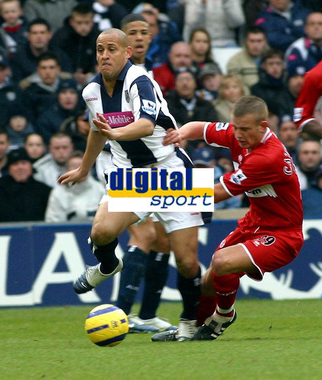 Photo: Dave Linney.<br />West Bromwich Albion v Middlesbrough. The Barclays Premiership. 26/02/2006West Broms's .Nigel Quashie (L) pushes Lee Cattermole off the ball