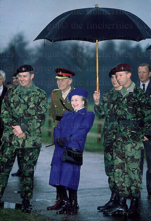 The Queen seen with members of the Lifeguards Regiment during a demonstration at Smith's Lawn,Windsor in December 1989. Photographed by Jayne Fincher