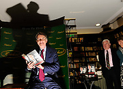 "Labour Party politician Lord Mandelson poses for photographs with a copy of his autobiography 'The Third Man', in a book shop in central London, July 15, 2010. Former Labour leader Neil Kinnock accused Lord Mandelson of becoming a ""caricature of himself"" over the book."