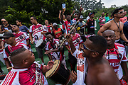 """Sao Paulo amateur """"Várzea"""" Championship between Colorado and Santa Cruz teams in Villa Formosa district, Sao Paulo city. Fans sing and dance to a Samba beat in support  of their team. `The amateur """"Várzea""""championship was born before the professional  game took hold throughout Brazil and its roots lie in the city of Sao Paulo, the creator of such a championship, which is fiercely contested by all teams that participate in the competition. It is wholly amateur and is funded ans supported by local businesses to the teams that participate."""