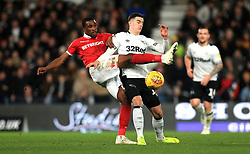 Nottingham Forest's Tendayi Darikwa (left) and Derby County's Tom Lawrence (right) battle for the ball during the Sky Bet Championship match at Pride Park, Derby.