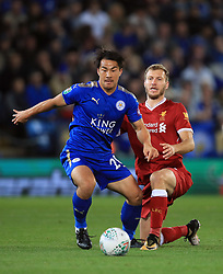 Leicester City's Shinji Okazaki (left) and Liverpool's Ragnar Klavan battle for the ball during the Carabao Cup, third round match at the King Power Stadium, Leicester.