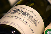 pile of bottles hautes cotes de beaune dom e monnot & f santenay cote de beaune burgundy france