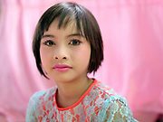 Portrait of a girl preparing for a procession at a Shinbyu Novice Ceremony on 21st March 2016 in Mo Bye village, Shan State, Myanmar. In Myanmar, it is customary for boys to enter the monastery as a Buddhist novice between the age of ten and 20 years old although they can be as young as four, for at least one week.