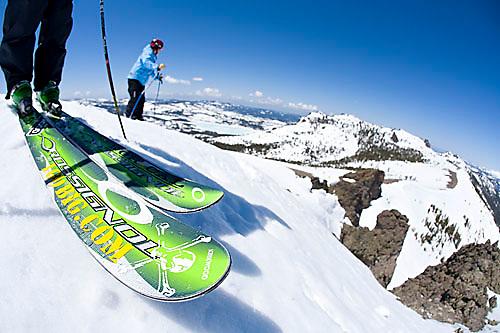 Group of skiers looking over edge at Kirkwood ski resort near Lake Tahoe, CA.