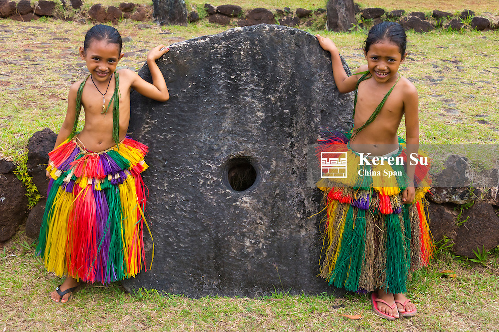 Yapese girls in traditional clothing with stone money at Yap Day Festival, Yap Island, Federated States of Micronesia