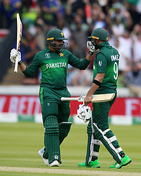 Pakistan's Haris Sohail (left) celebrates reaching his half century during the ICC Cricket World Cup group stage match at Lord's, London.
