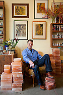 Mark Bitterman, owner of The Meadow, a salt shop in the North Mississippi neighborhood of Portland, Oregon surrounded by blocks of pink Himalyan Salt which are used for cooking and serving food.
