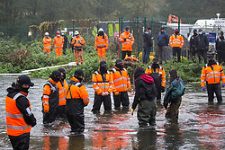 HS2 security guards monitor anti-HS2 activists wading in the river Colne at Denham Ford in order to try to delay bridge building works for the HS2 high-speed rail link on the first day of the second national coronavirus lockdown on 5 November 2020 in Denham, United Kingdom. Prime Minister Boris Johnson has advised that construction work may continue during the second lockdown but those working on construction projects are required to adhere to Site Operating Procedures including social distancing guidelines to help prevent the spread of COVID-19.