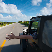 Driving Jeep On Empty Seaside Road, Cozumel, Mexico