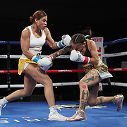 Melissa Parker (L) fights Maria Roman during a One For All Promotions boxing event at the Caribe Royale Orlando Events Center on Saturday, February 20, 2021 in Orlando, Florida. (Alex Menendez via AP)