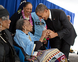 President Barack Obama greets former foot soldier Amelia Boynton Robinson, 103 years old, backstage before an event to commemorate the 50th Anniversary of Bloody Sunday and the Selma to Montgomery civil rights marches, at the Edmund Pettus Bridge in Selma, Ala., March 7, 2015. (Official White House Photo by Pete Souza)<br /> <br /> This official White House photograph is being made available only for publication by news organizations and/or for personal use printing by the subject(s) of the photograph. The photograph may not be manipulated in any way and may not be used in commercial or political materials, advertisements, emails, products, promotions that in any way suggests approval or endorsement of the President, the First Family, or the White House.
