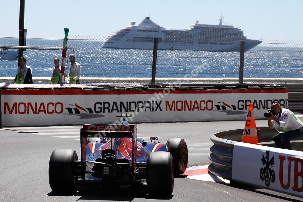 Daniil Kvyat (Roro Rosso-Renault) with cruise ship at the 2014 Monaco Grand Prix. Photo : Grand Prix Photo