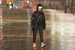 © Licensed to London News Pictures. 14/01/2021. Leeds, UK. A woman  walks in Leeds city centre during heavy snow this morning. Photo credit: Ioannis Alexopoulos/LNP