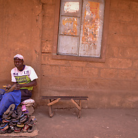 Shoe Mender by Lucy Tabu