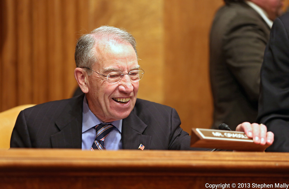 Senator Chuck Grassley (R-IA) puts out his name plate before the start of a hearing before the Senate Budget Committee in the Dirksen Senate Office Building in Washington, DC on Wednesday, April 10, 2013.