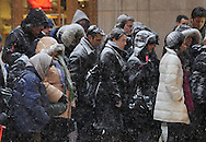 Pedestrians wait to board a bus as a major snow storm hits on February 1, 2011 in Chicago. Up to two feet of snow is expected to fall in the Chicago area as a winter storm created blizzard conditions from the southern Great Plains to the upper midwest on Tuesday.  (UPI)