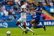 Bournemouth forward Jaidon Anthony  (32) under pressure from Cardiff City defender Curtis Nelson  (16) during the EFL Sky Bet Championship match between Cardiff City and Bournemouth at the Cardiff City Stadium, Cardiff, Wales on 18 September 2021.