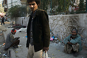 A homeless mentally ill man who is also a heroin addict stands on the street holding a bag of his possessions, Delhi, India<br /> <br /> It is estimated that around than 150000 people - more than one percent of the city - is homeless and, with constant migration this is increasing on a daily basis. The incidence of mental illness amongst this group is very high. Delhi has little formal provision to deal with such a situation. Countrywide there are no more than 400 registered psychiatrists. Delhi, India