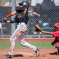 032815       Cable Hoover<br /> <br /> Gallup Bengal Isiah Malcom (12) knocks the ball away from Bernalillo Spartans catcher Marcello Chavez (2) Saturday at the Gallup Sports Complex.