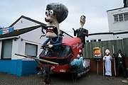 """Effigies of Theresa May, Rees-Mogg, Trump, Guy Fawkes and the Pope.<br /><br />Lewes Bonfire, describes a set of celebrations held in the town of Lewes, Sussex that constitute the United Kingdom's largest and most famous Bonfire Night festivities. Held on 5 November, the event not only marks Guy Fawkes Night - the date of the uncovering of the Gunpowder Plot in 1605 - but also commemorates the memory of the seventeen Protestant martyrs from the town burned at the stake for their faith during the Marian Persecutions. Lewes is home to the largest and most celebrated of the festivities in the Sussex bonfire tradition. There are seven societies putting on six separate parades and firework displays throughout Lewes on November the 5th. As well as this, 25-30 societies from all around Sussex come to Lewes on the fifth to march the streets. There is a history of religious antagonism and anti-popery around the bonfire celebrations in Lewes. A number of large effigies are drawn through the streets before being burned at the bonfires, these """"Enemies of Bonfire"""" range from nationally reviled figures to local officials."""