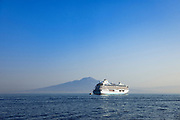 Cruise ship anchored on the Gulf of Naples with Mount Vesuvius in the bacground, Naples, Italy