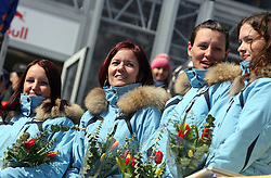 Hostesses at flowers ceremony at Flying Hill Team in 3rd day of 32nd World Cup Competition of FIS World Cup Ski Jumping Final in Planica, Slovenia, on March 21, 2009. (Photo by Vid Ponikvar / Sportida)