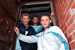 Group of teenage boys doing work experience painting houses for a Housing Association Beeston; Leeds UK