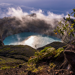 The tricolored volcanic lakes of Kelimutu are located on the island of Flores near the small town of Moni. Besides the unique beauty of the sight, these lakes have a fascinating backstory. There are three different lakes together where locals believe their ancestors' spirits live on. The westernmost lake is called the Lake of Old People (Tiwu Ata Mbupu). If you live a good life, your spirit will go to this lake after you die. This lake is usually blue. The other two lakes are right next to each other. The Lake of Young Men and Maidens (Tiwu Nuwa Muri Koo Fai) is most often an emerald color. The Enchanted Lake (Tiwu Ata Polo) is famously blood red and it's where bad spirits go.