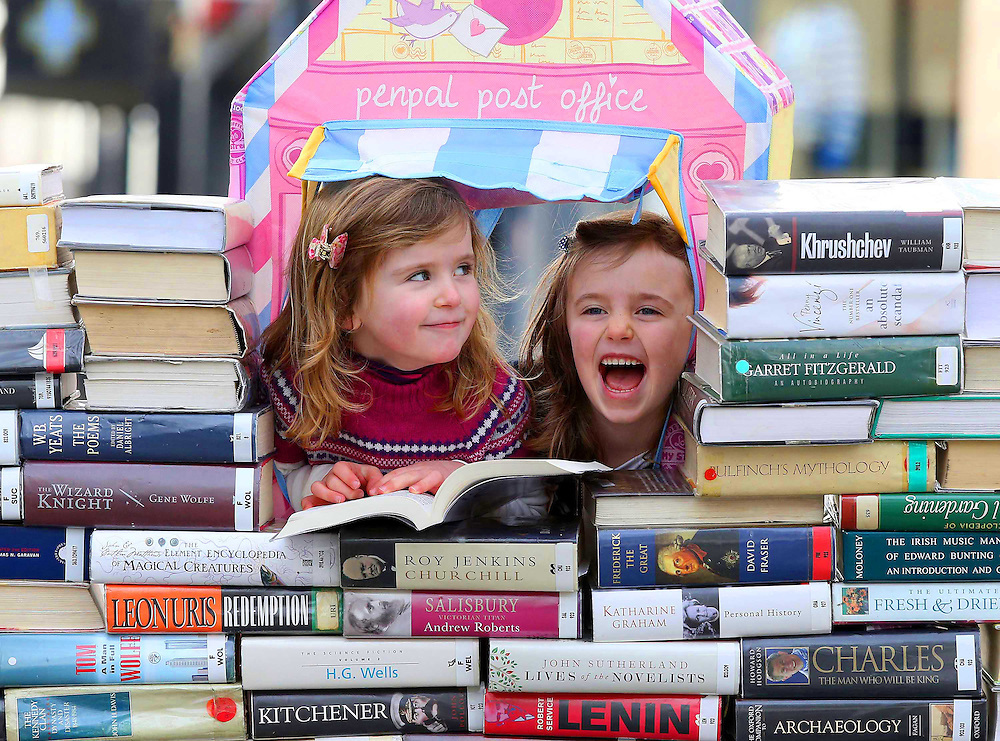 """REPRO FREE. 10/02/2013. Free To Use Image. Waterford Writers Weekend. Pictured at Waterford City at a photocall for the Third Annual Waterford Writers Weekend. Pictured are Rosie and Katie Flynn getting in some light reading. The country's top authors will descend on Waterford City for four days next month from March 21 to 24 to impart their knowledge and stories to keen literary audiences. The programme for the fourth annual Waterford Writers Weekend festival was launched in the city centre today, Sunday February 10, 2013. Picture: Patrick Browne<br /> <br /> Ireland's Top Authors to Descend on Third Annual Waterford Writers' Weekend<br />  <br /> The country's top authors will descend on Waterford City for four days next month from March 21 to 24 to impart their knowledge and stories to keen literary audiences. The programme for the fourth annual Waterford Writers Weekend festival was launched in the city centre today, Sunday February 10, 2013.<br />  <br /> Award winning authors such as Jimmy Magee, Kate Kerrigan, Hazel Gaynor, Anna Carey, Ferdia MacAnna and Dave Duggan will appear, to name but a few. In all, thirty-two authors, journalists and bloggers will host readings, writing workshops, debates and discussions for avid readers, novice writers, children and anyone with an interest in the magic of books.<br />  <br /> Launching the programme for the 2013 festival Director of the Waterford Writers' Weekend Katherine Collins said, """"We are delighted to be launching this amazing line-up of renowned authors and speakers for this our third festival; this festival has grown enormously over the last few years and only because we have such an interest from the public, we have full houses every year and we are looking forward to welcoming visitors old and new again this year.""""<br />  <br /> Opening the festival on Thursday March 21 are the Seán Dunne Young Writers' Awards. The Awards are a tribute to the work of the late poet, and continue to promote the work of aspirin"""