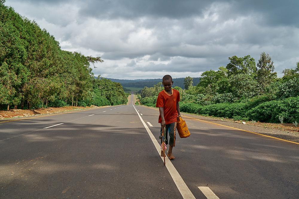 A boy plays with a wheel on the Agaramarim-Yebllo Road, Ethiopia.