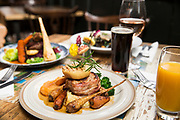 Dow0075165 . Sunday Telegraph<br /> <br /> ST Home & Living<br /> <br /> Roast Carroway stuffed pork loin with Pancetta, Apple fondant, Sprout tops, Baby root veg, Swede puree and Gravy .<br /> <br /> Hastings 5 February 2017