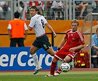Photo: Glyn Thomas.<br />England v Trinidad & Tobago. Group B, FIFA World Cup 2006. 15/06/2006.<br /> England's Frank Lampard (L) and Trinidad & Tobago's Chris Burchill.