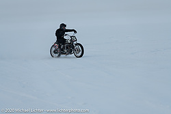 Photographer Aleksei Kalabin of Moscow having fun in the snow on his Kawasaki w650 racer during the Baikal Mile Ice Speed Festival. Maksimiha, Siberia, Russia. Saturday, February 29, 2020. Photography ©2020 Michael Lichter.