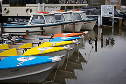 Pleasure boats add a splash of colour on a wet bank holiday Monday at Henley on Thames in Oxfordshire as heavy rains in the River Thames catchment area and saturated ground causes the river to rise to within inches of bursting its banks.. April 02 2018.