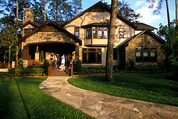 Stock photo of a home with the family on the front porch
