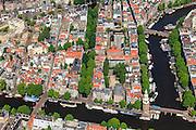 Nederland, Noord-Holland, Amsterdam, 14-06-2012; overzicht binnenstad met in de voorgrond de Oude Schans en Montelbaanstoren. Gedeelte van de Nieuwmarktbuurt, begrensd door de Oudeschans (beneden) en Waalseilandgracht (Binnenkant, Oude en Kromme Waal) rechts. Recht Boomssloot in het midden met bomen. Overview old town of Amsterdam, Oudeschans, and Montelbaanstoren, Nieuwmarktbuurt,  .luchtfoto (toeslag), aerial photo (additional fee required).foto/photo Siebe Swart