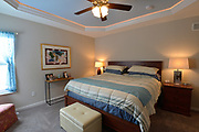 The master bedroom has a light blue ceiling, and recessed lighting around the perimeter of the cove. Sheridan and Rikki Glen are At Home in their Tanglewood subdivision home in Caseyville, IL on Wednesday January 16, 2019. <br /> Photo by Tim Vizer