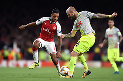 Theo Walcott of Arsenal competes with KonstantinRausch of Cologne - Mandatory by-line: Patrick Khachfe/JMP - 14/09/2017 - FOOTBALL - Emirates Stadium - London, England - Arsenal v Cologne - UEFA Europa League Group stage